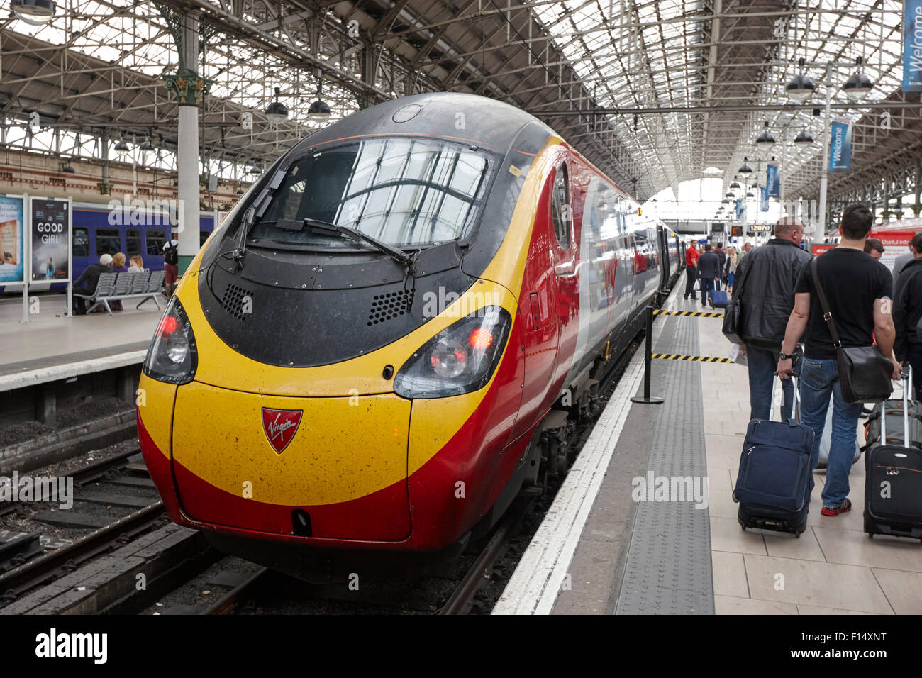virgin trains pendolino train at platform in Piccadilly train station Manchester UK - Stock Image