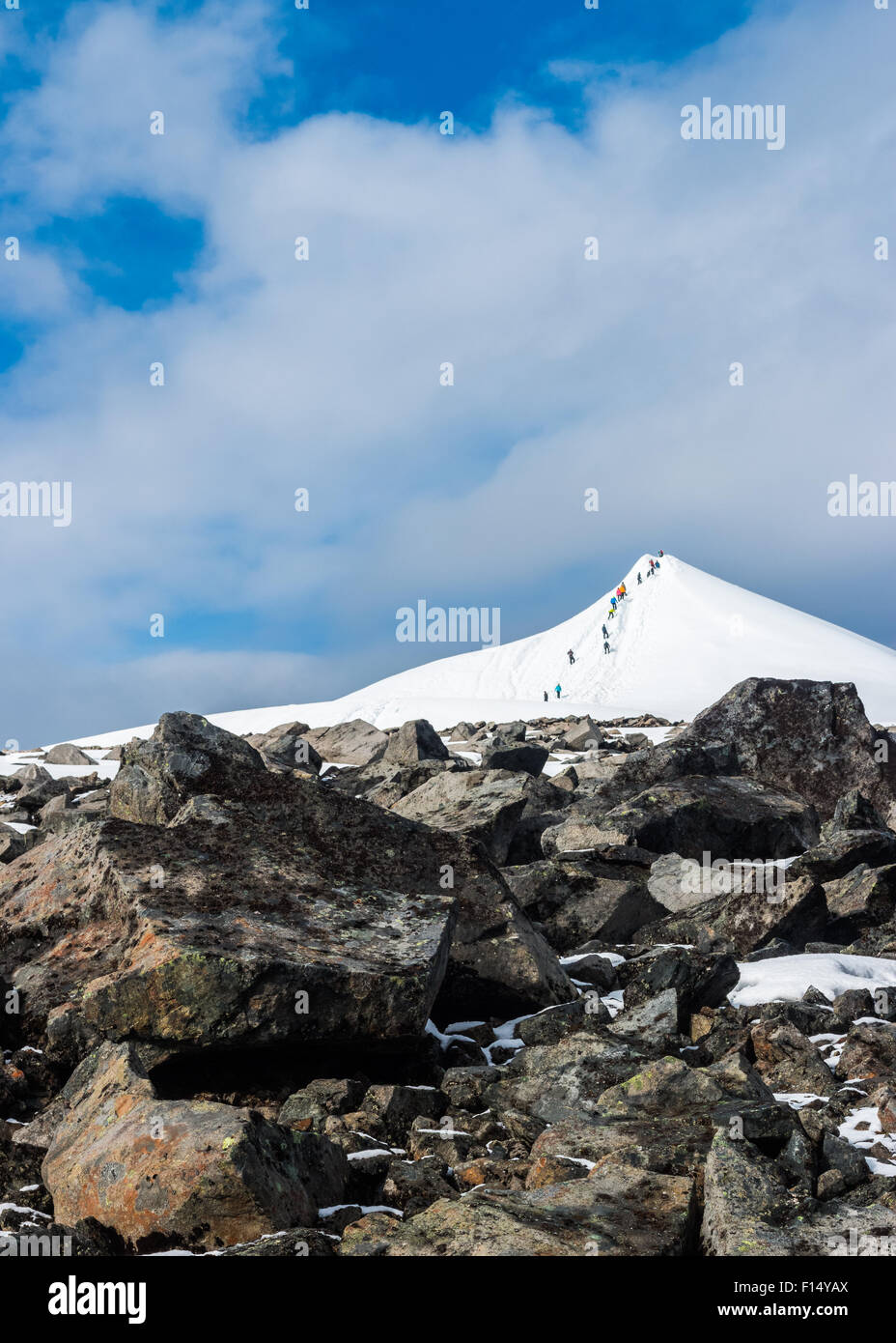 People climbing to the top of Kebnekaise. - Stock Image
