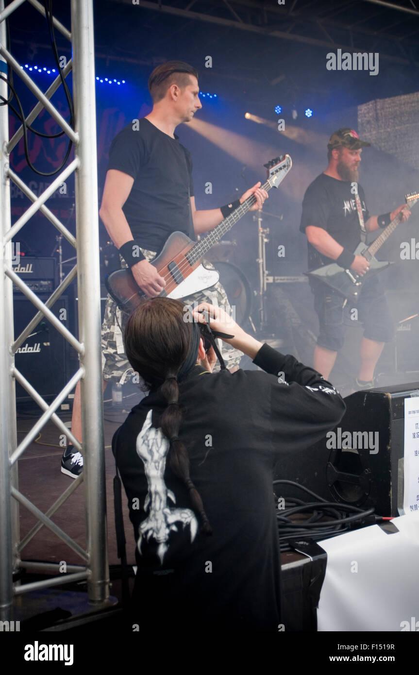 rock music photographer photographers stage live performance photograph photographing musicians - Stock Image