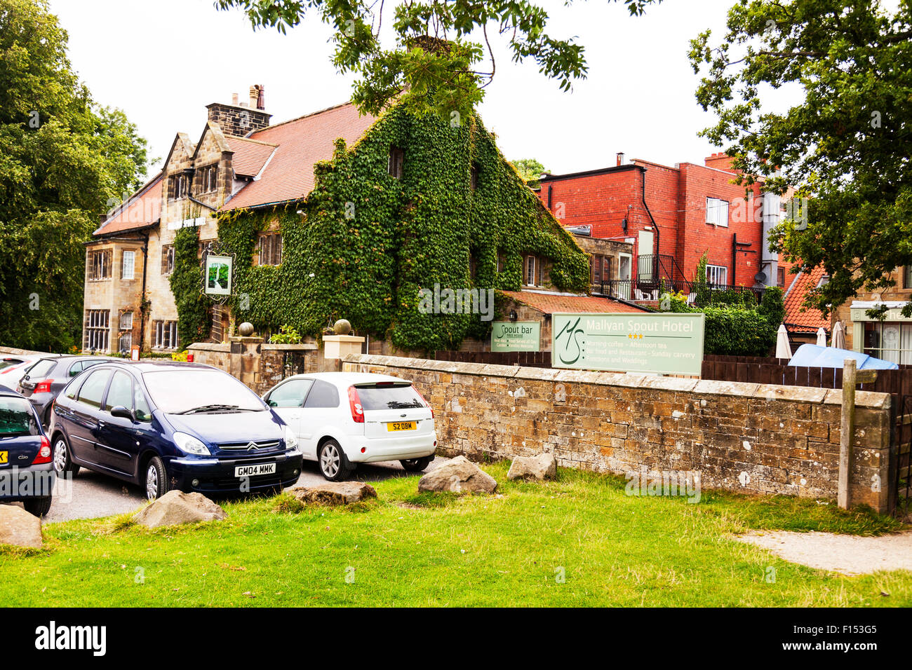 Mallyan Spout Hotel pub restaurant building Goathland North Yorkshire UK England exterior front sign - Stock Image