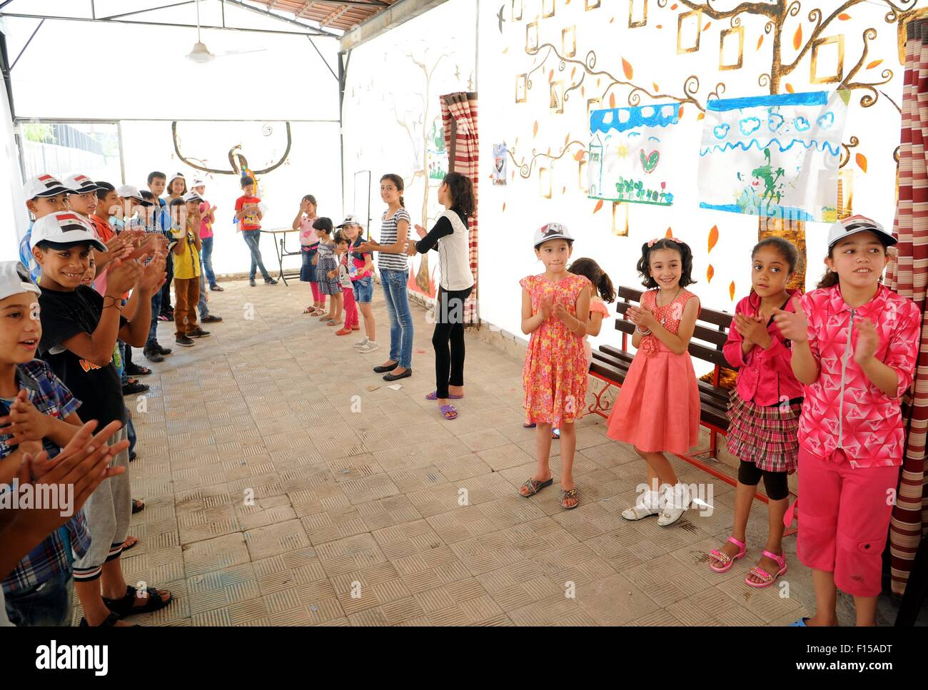 Damascus. 27th Aug, 2015. Syrian children sing during an extracurricular activity at a makeshift workshop in Damascus, Stock Photo