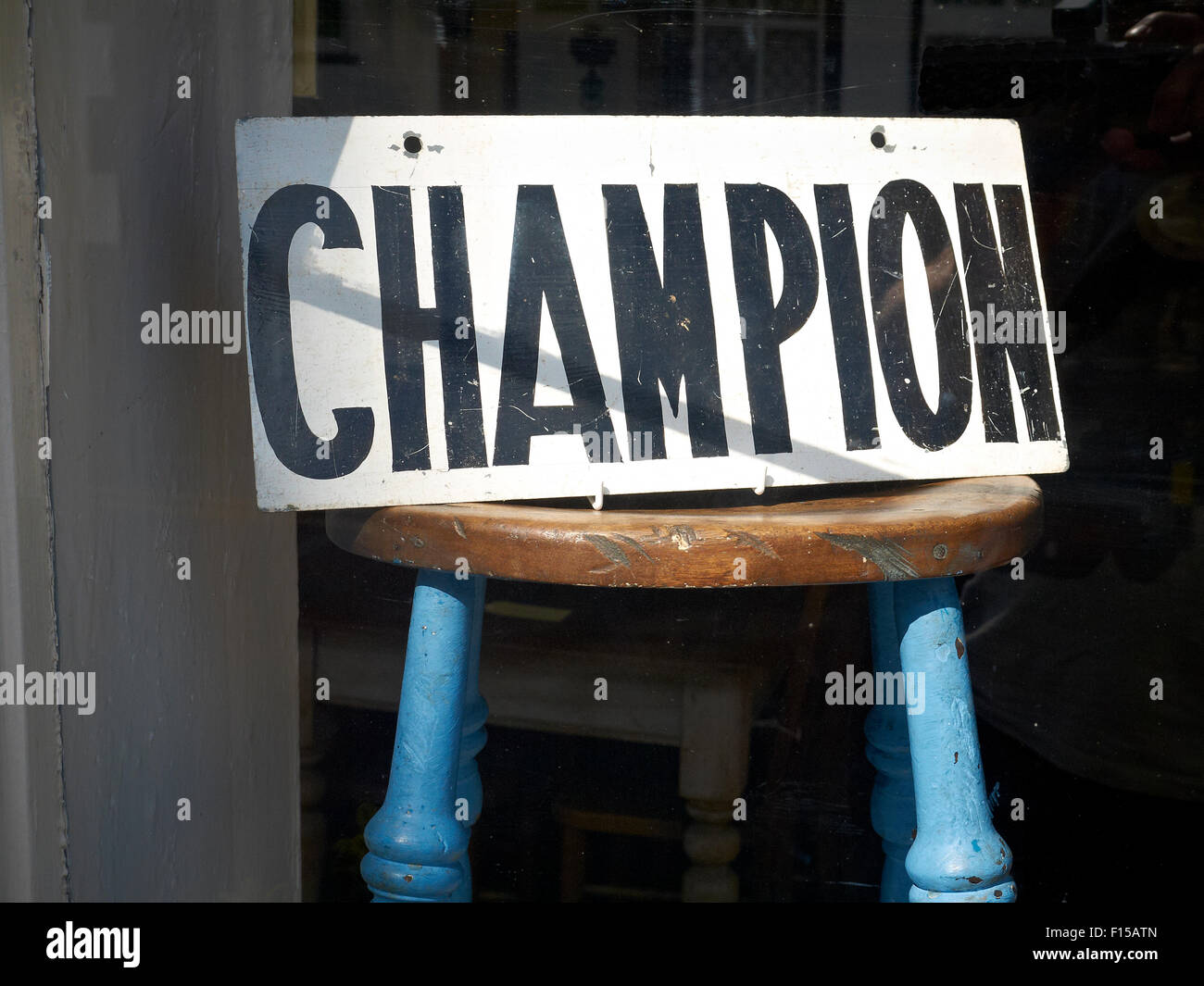 Champion sign in antique shop UK - Stock Image