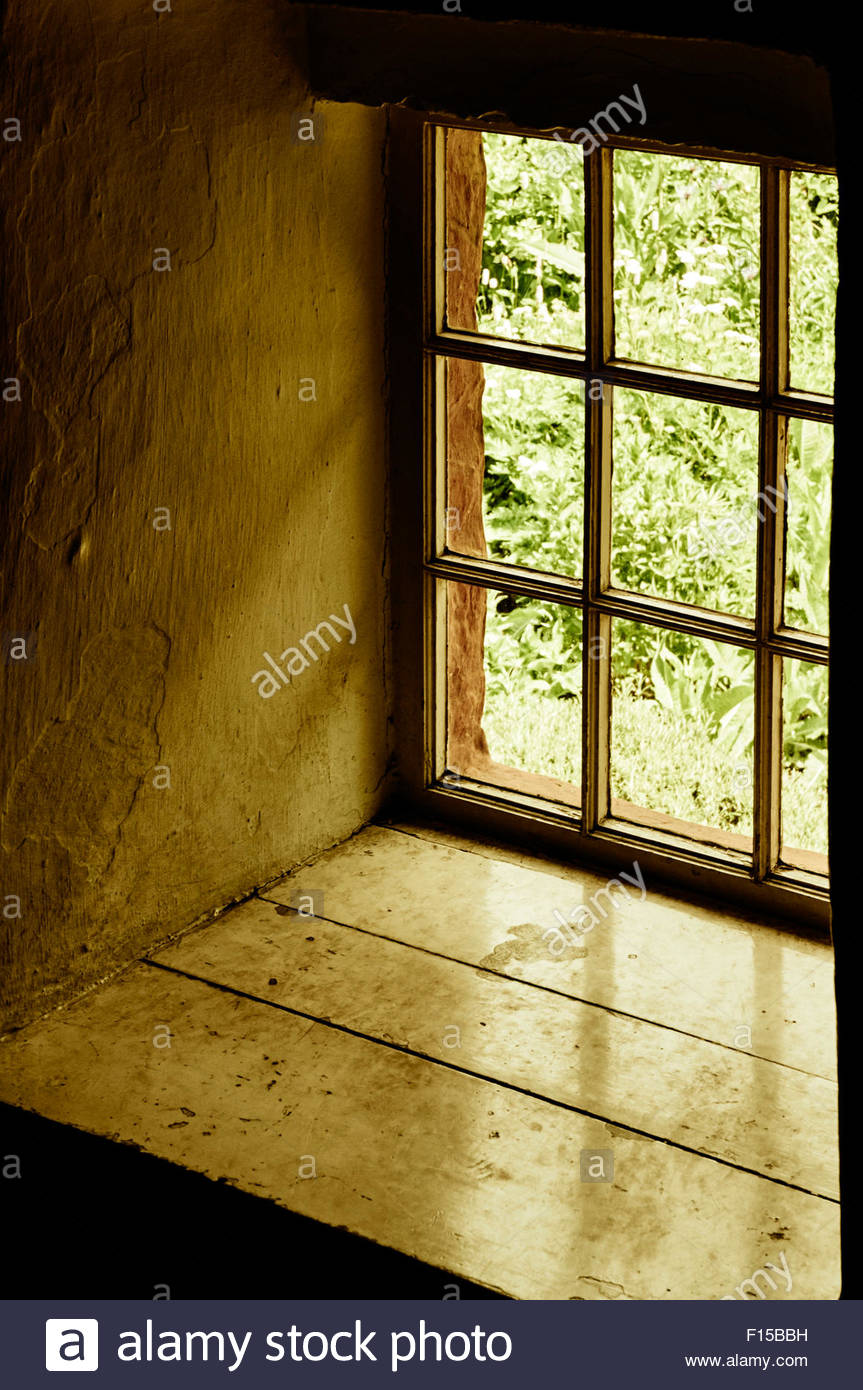 old wooden window with small panes of glass and a wide. Black Bedroom Furniture Sets. Home Design Ideas