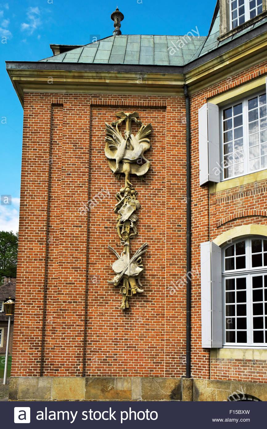 Sculptural detail on exterior of building at Schloss Clemenswerth, Sögel, Niedersachsen, Germany - Stock Image