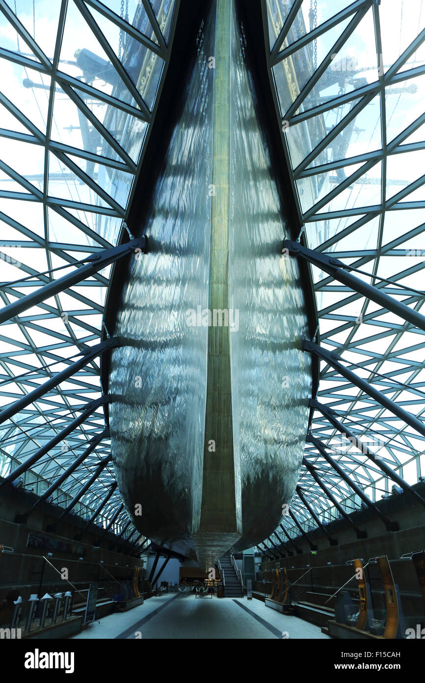The brass covered keel of the Cutty Sark at Greenwich, London, England. - Stock Image