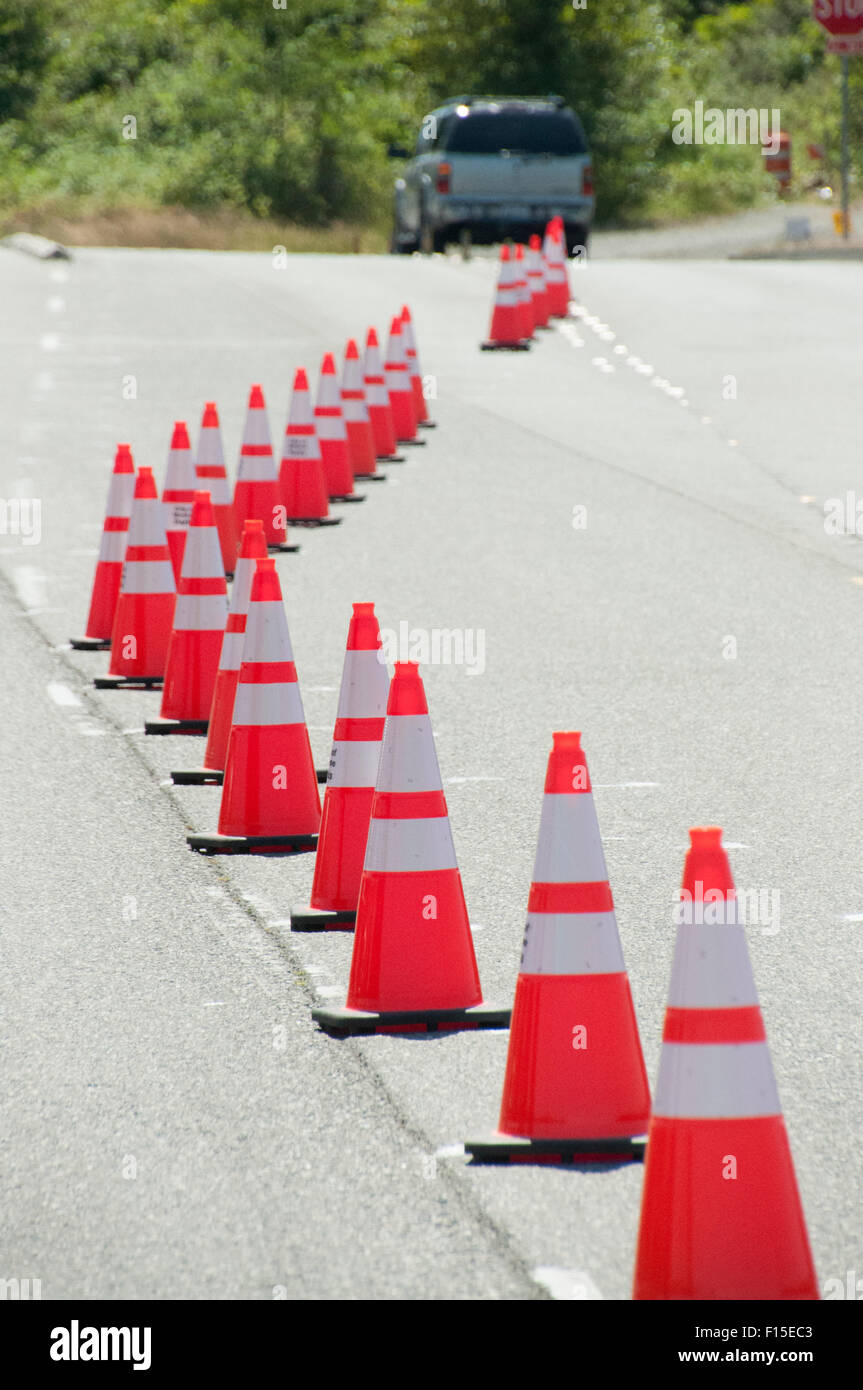 Traffic cones set up on a roadway. - Stock Image