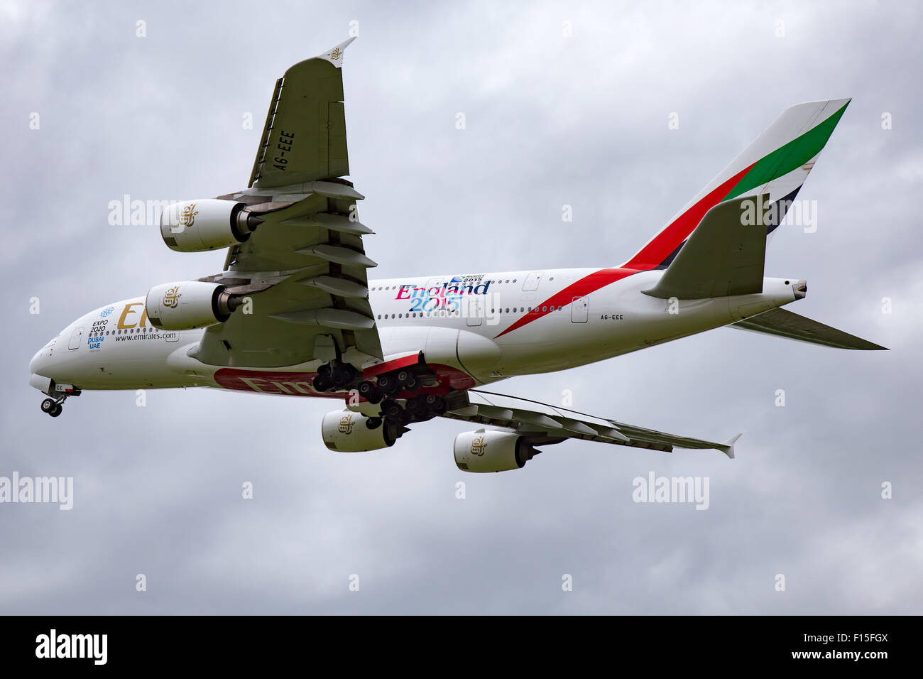 Emirates Airbus A380-800 climbs away from runway 05L at Manchester airport. - Stock Image