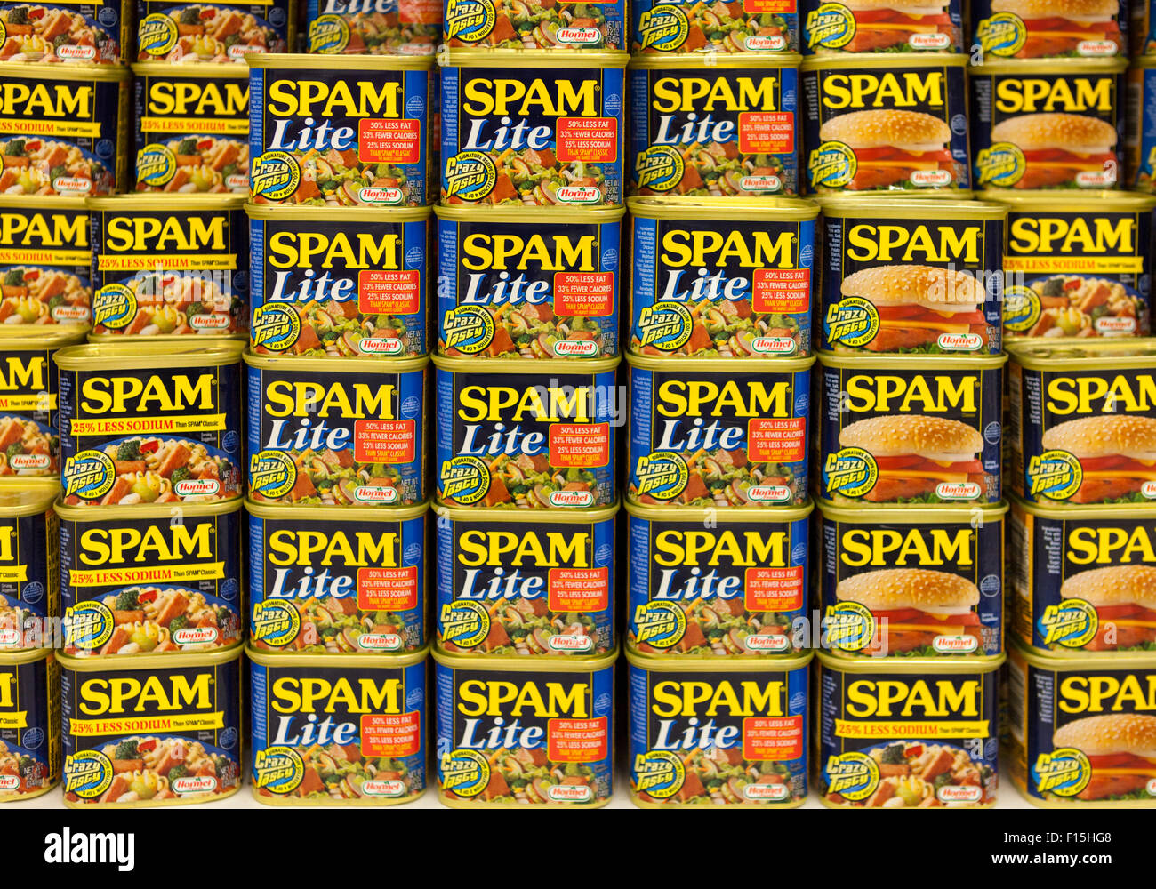 Cans of various varieties of Spam stacked for sale in a supermarket in Waimea, Big Island, Hawaii - Stock Image
