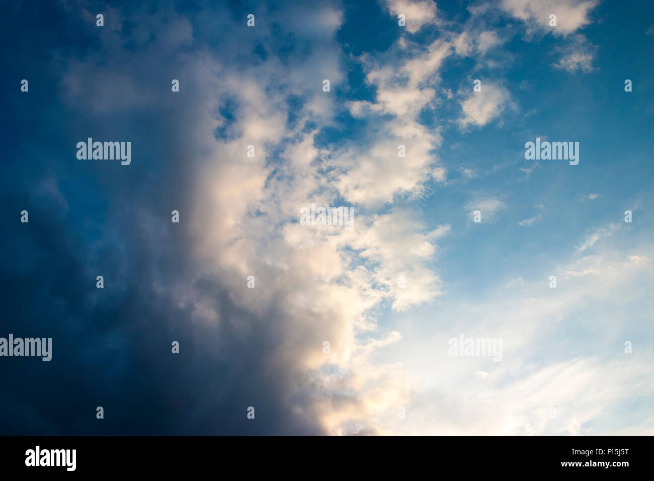 Soft, fluffy clouds in the sky - Stock Image