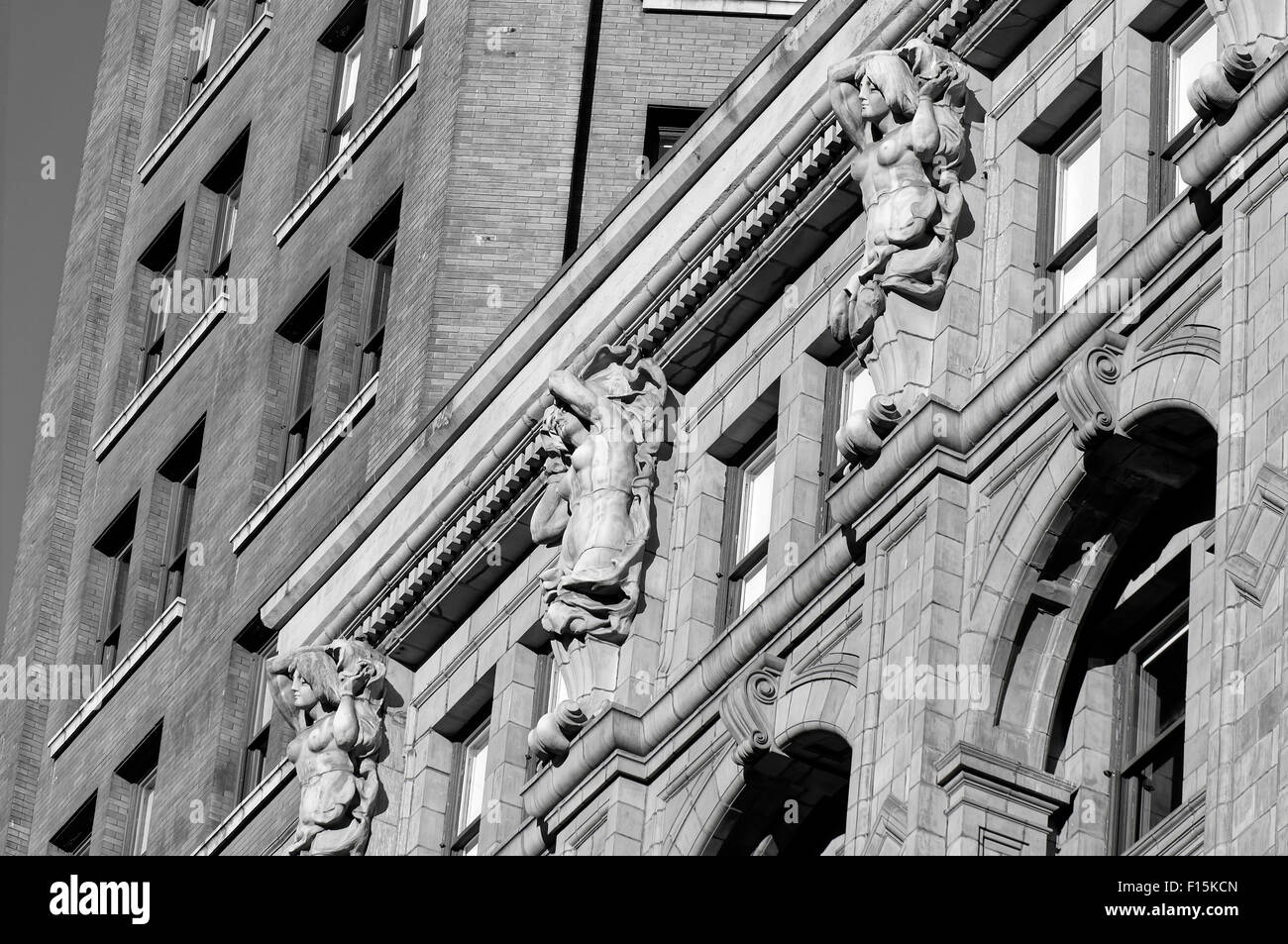 Terracotta caryatids on the facade of the Beaux-Arts Sun Tower building in downtown Vancouver, British Columbia, Stock Photo