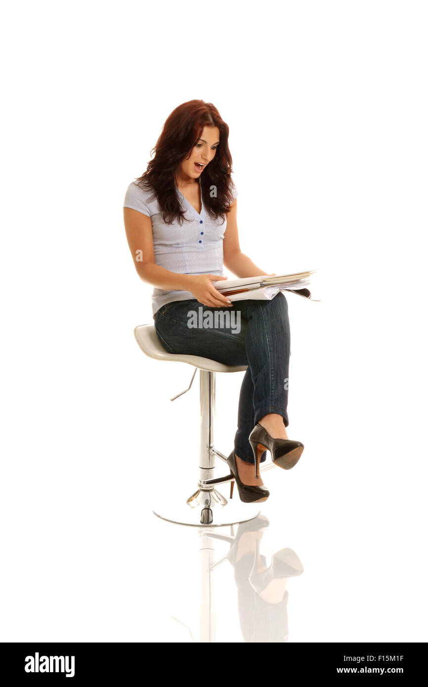 A business woman discovering some confidential documents - Stock Image