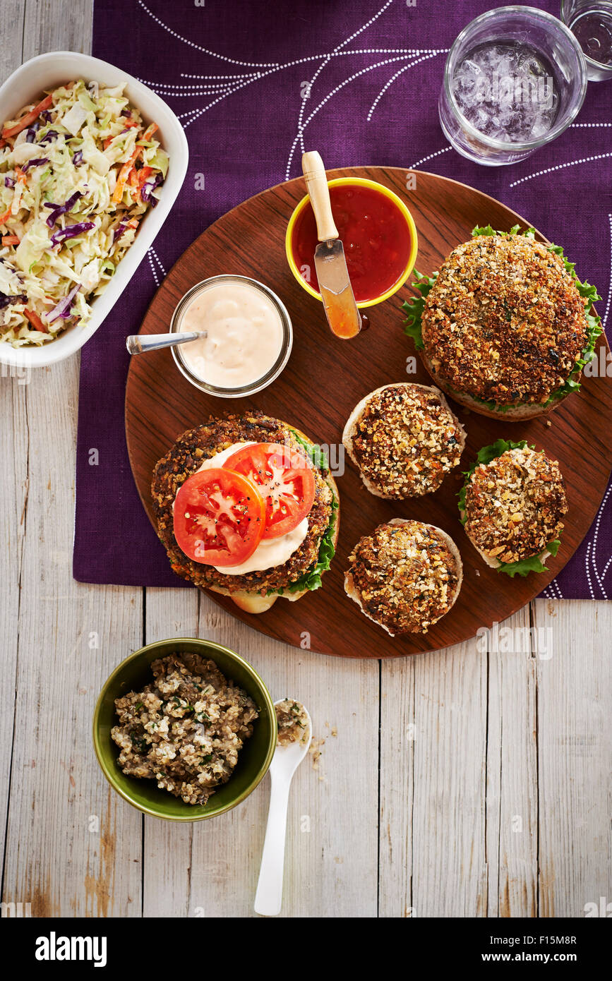 Vegetarian Burgers On A Platter With Side Dishes Studio Shot Stock Photo Alamy