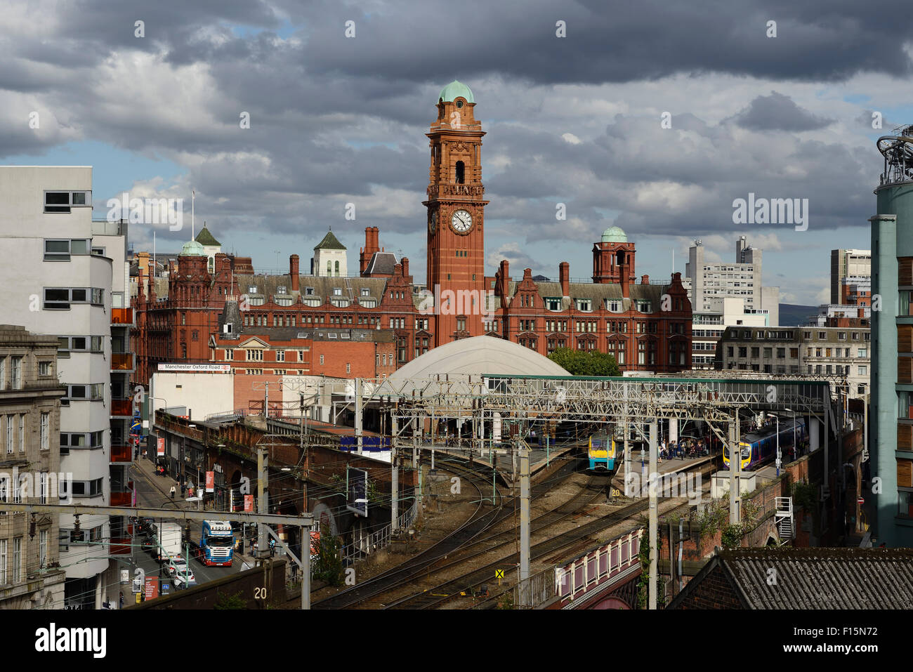 Manchester Oxford Road railway station and the Palace Hotel building in Manchester city centre UK - Stock Image