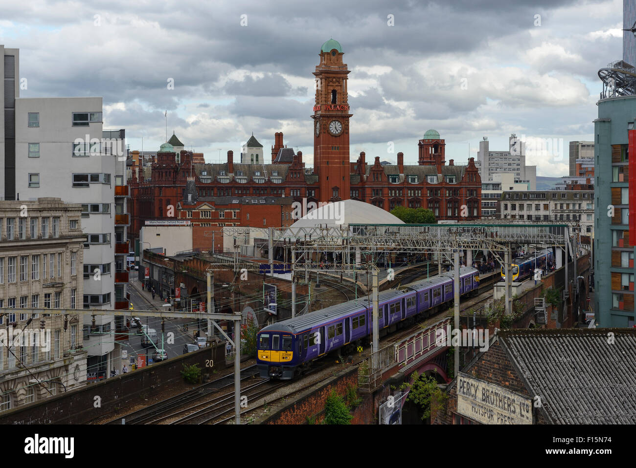 A Northern Rail commuter train leaves Manchester Oxford Road railway station in Manchester city centre UK - Stock Image