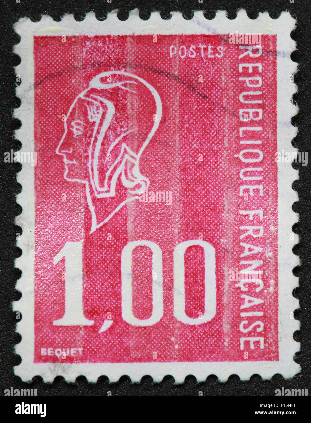 1f 1.00 Postes Republique Francaise BEQUET face pink red Stamp Stock Photo