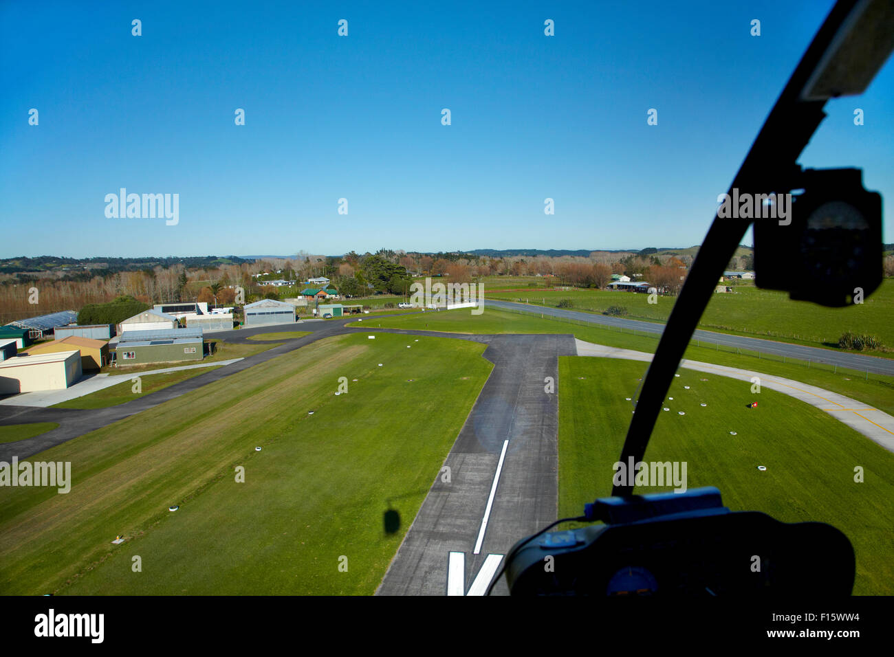 Runway of North Shore Aerodrome (aka Dairy Flat Airfield), seen from Robinson R22 helicopter, Dairy Flat, Auckland, - Stock Image