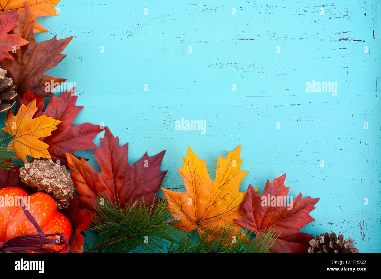Autumn Fall Rustic Background On Aqua Blue Vintage Distressed Wood With Leaves And Decorations
