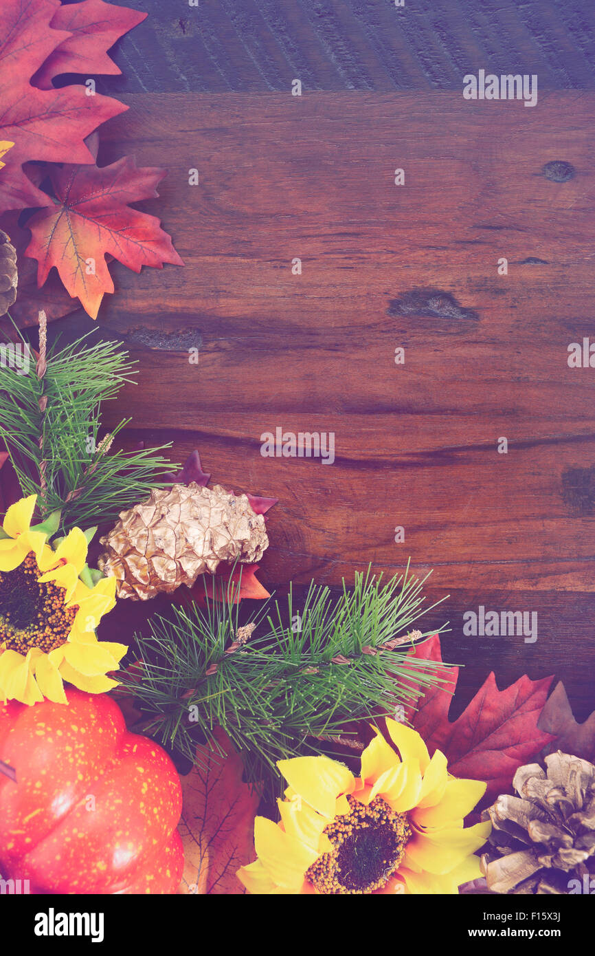Autumn Fall Rustic Background On Vintage Distressed Dark Wood With Leaves And Decorations Added Retro Style
