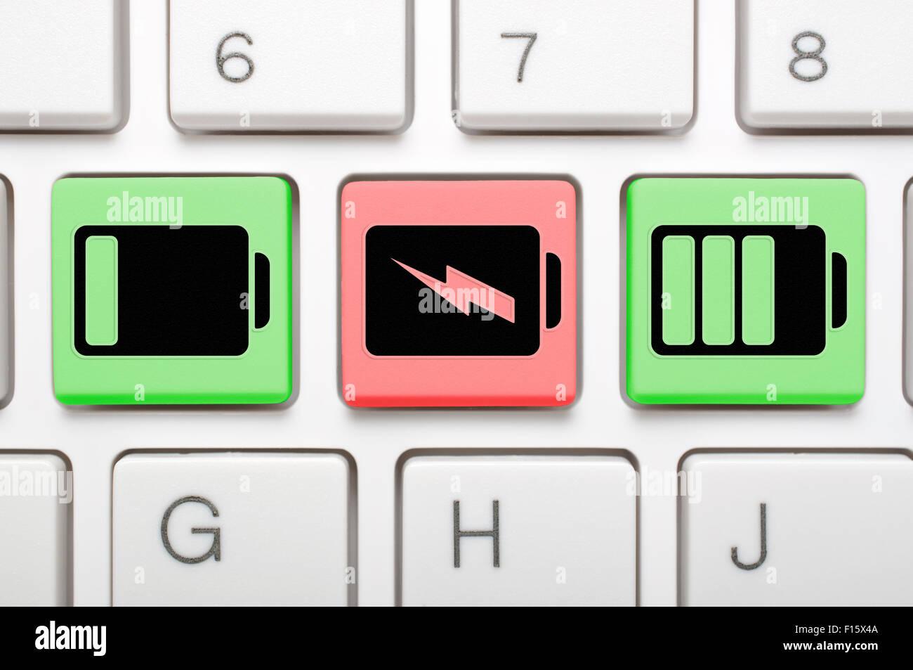 Battery charging status key on keyboard - Stock Image