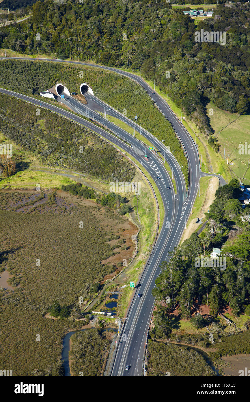 State Highway One at Johnstone's Hill Tunnels, North Auckland, North Island, New Zealand - aerial - Stock Image