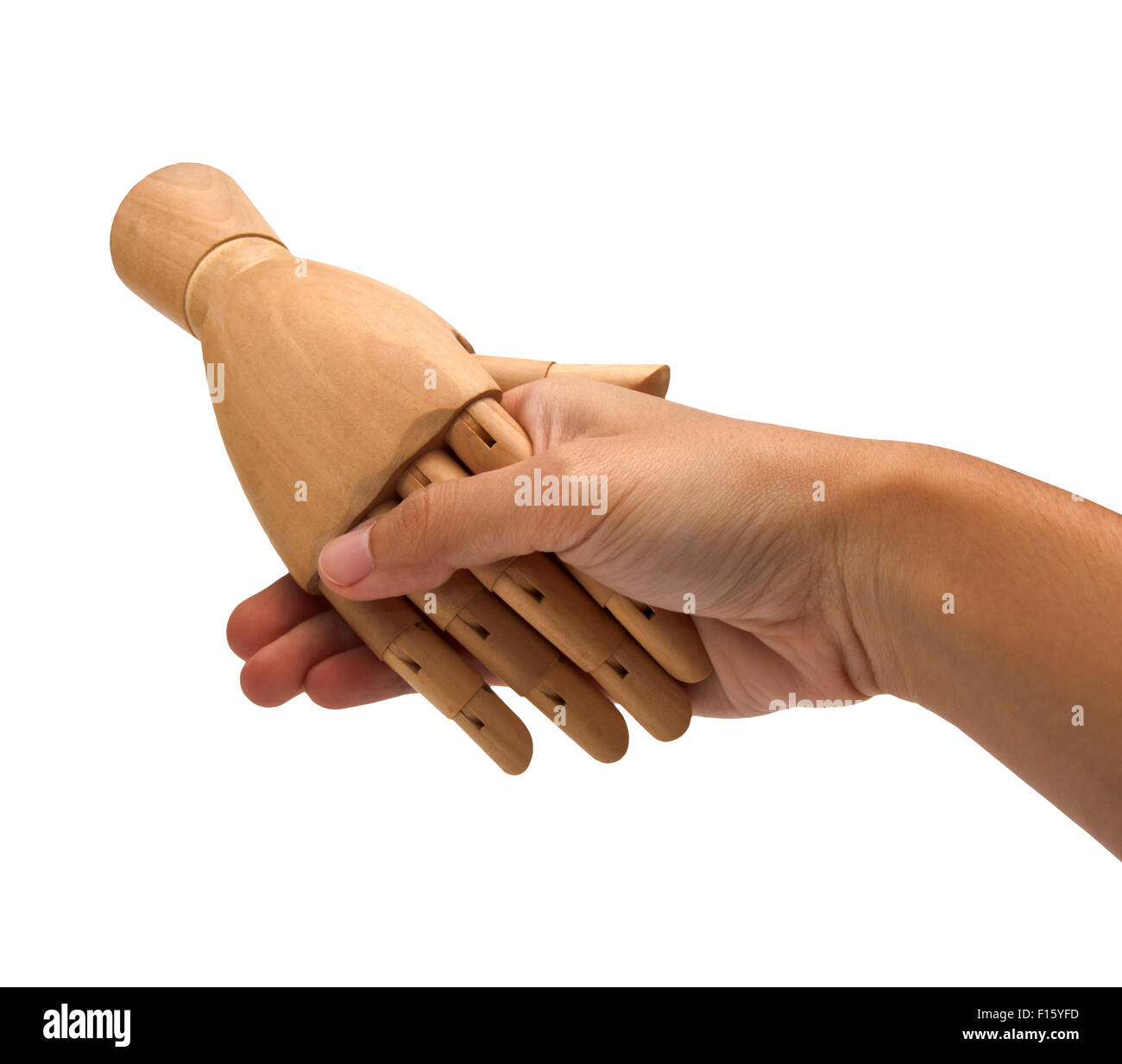 Handshake between a human hand and a wooden hand - Stock Image