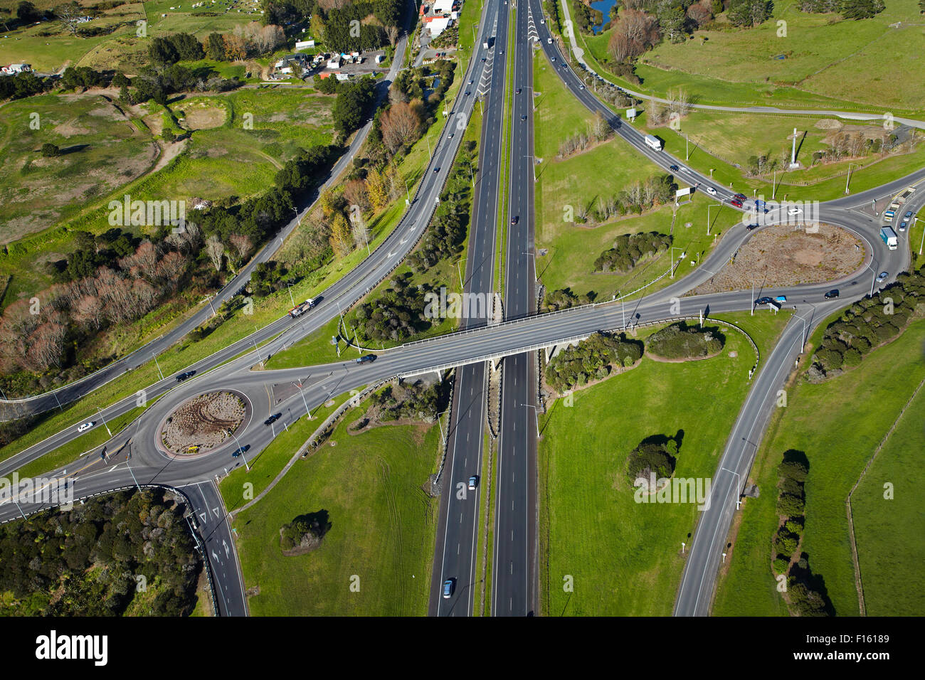 Northern Motorway interchange at Silverdale, North Auckland, North Island, New Zealand - aerial - Stock Image