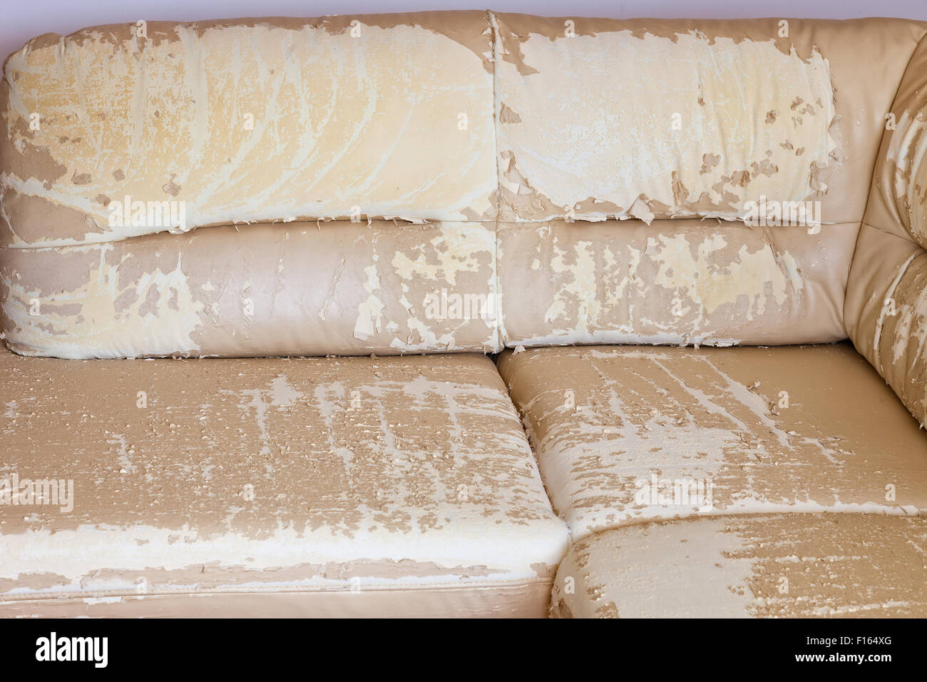 Beige damaged or cracked synthetic leather texture. - Stock Image
