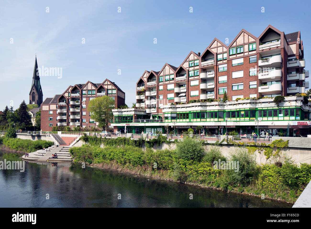 Residential and commercial buildings along the river Lippe, Lünen, Ruhr district, North Rhine-Westphalia, Germany - Stock Image