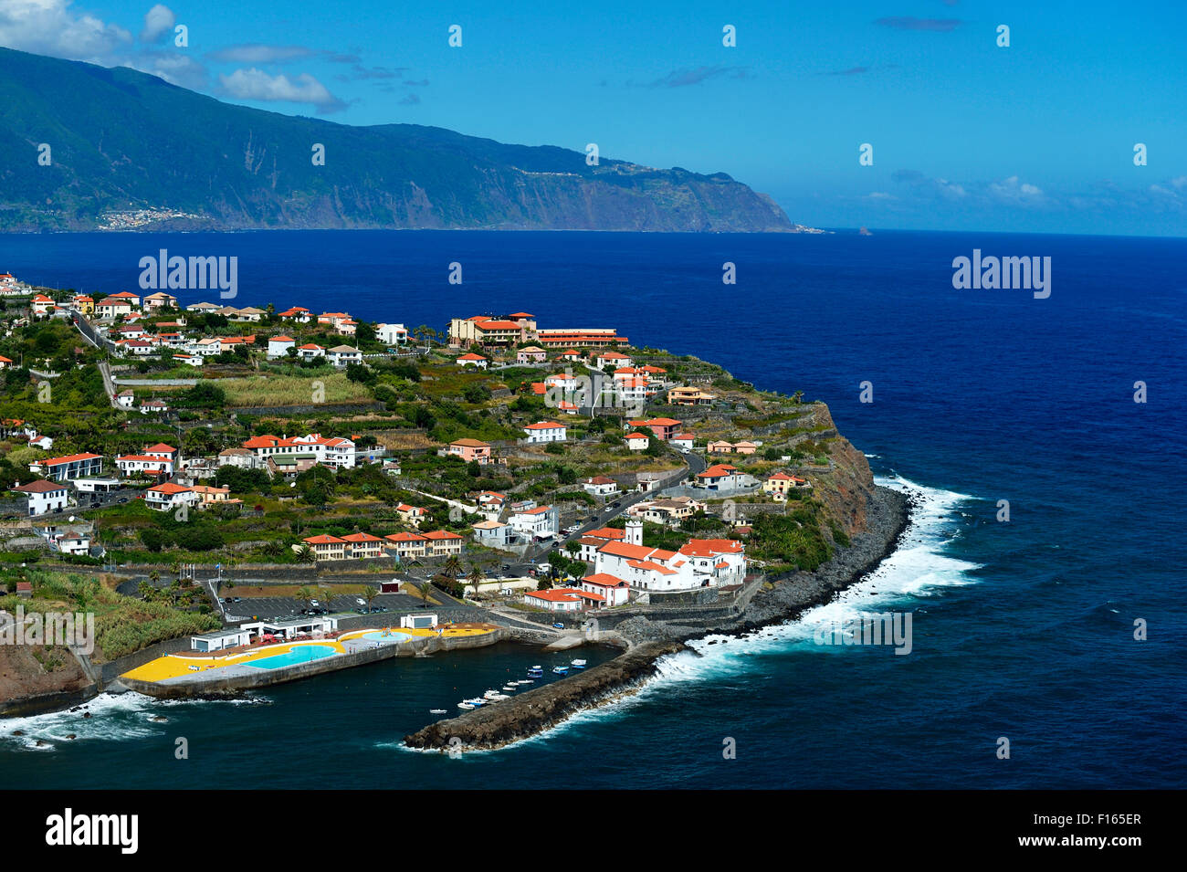 View of the town and harbor, north coast, Ponta Delgada, Madeira, Portugal - Stock Image