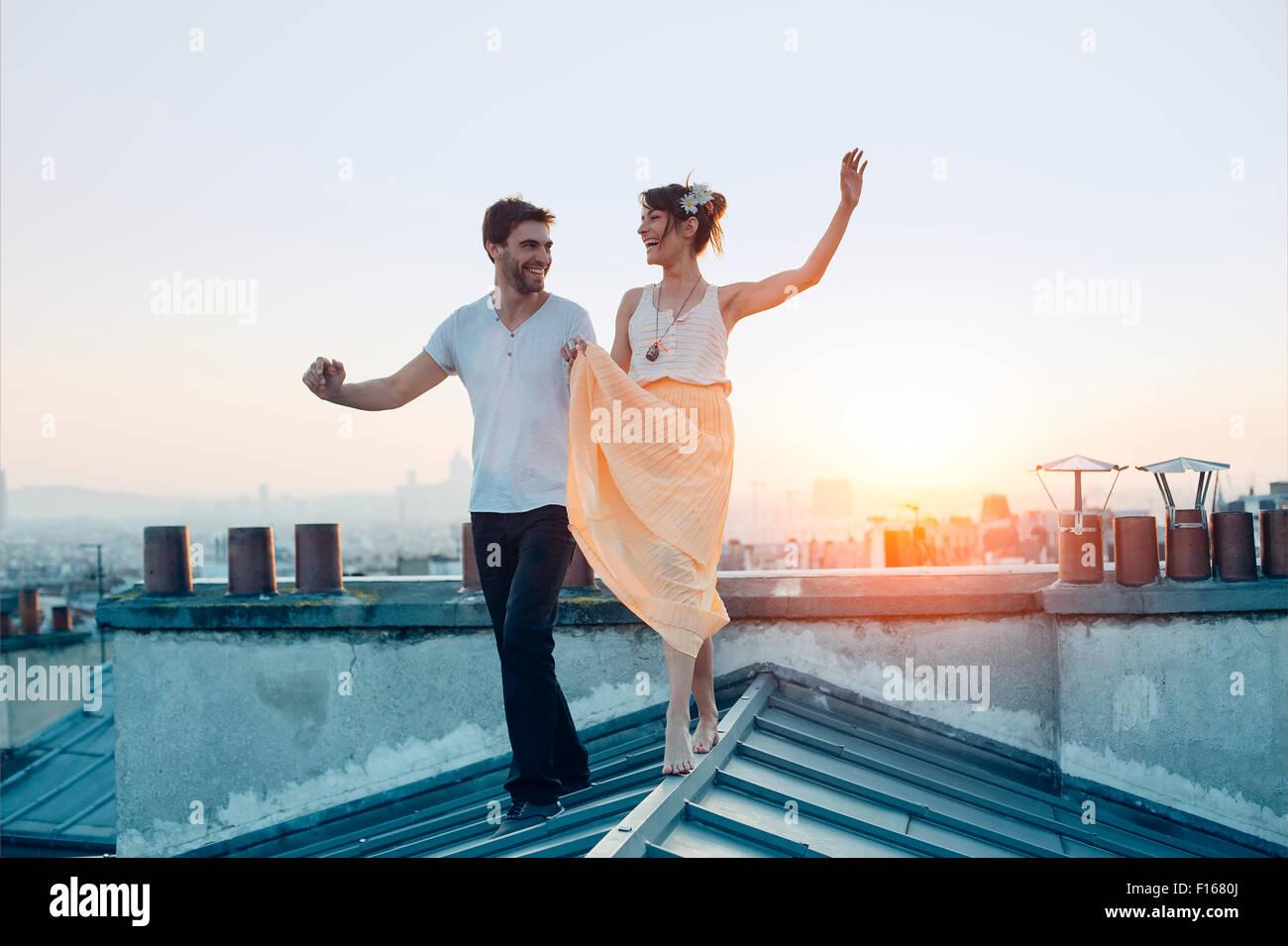 Paris, Couple walking on paris's roofs - Stock Image