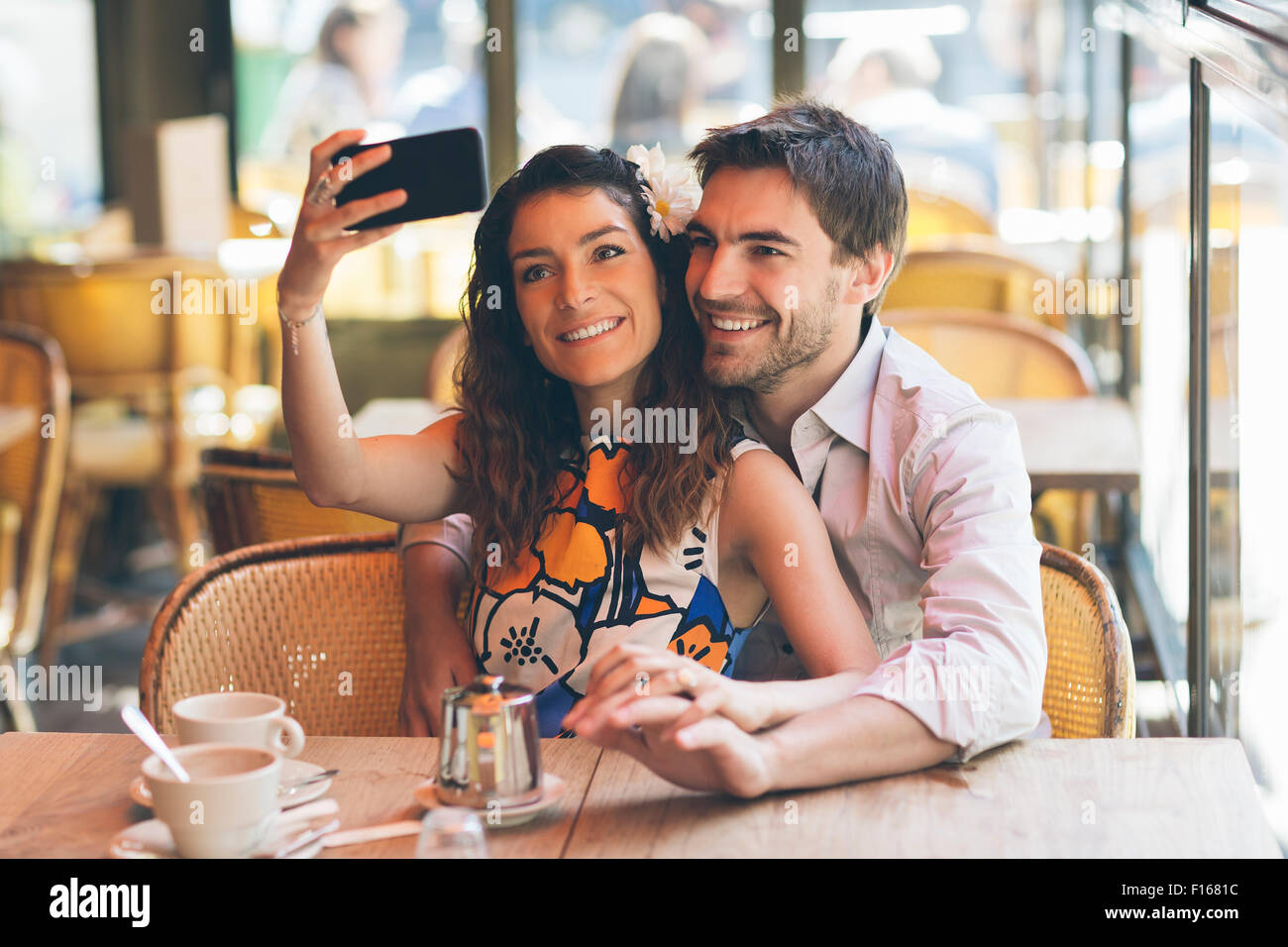 Paris, couple dating in Cafe Stock Photo