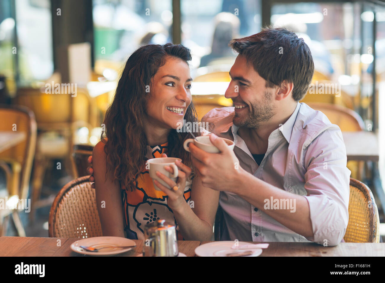 Couple dating in cafe, Paris - Stock Image