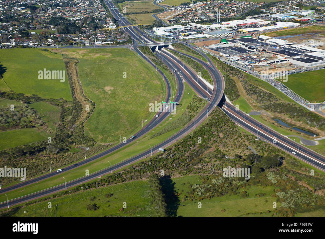 Upper Harbour Motorway, and Westgate Shopping Centre, Massey, Auckland, North Island, New Zealand - aerial - Stock Image