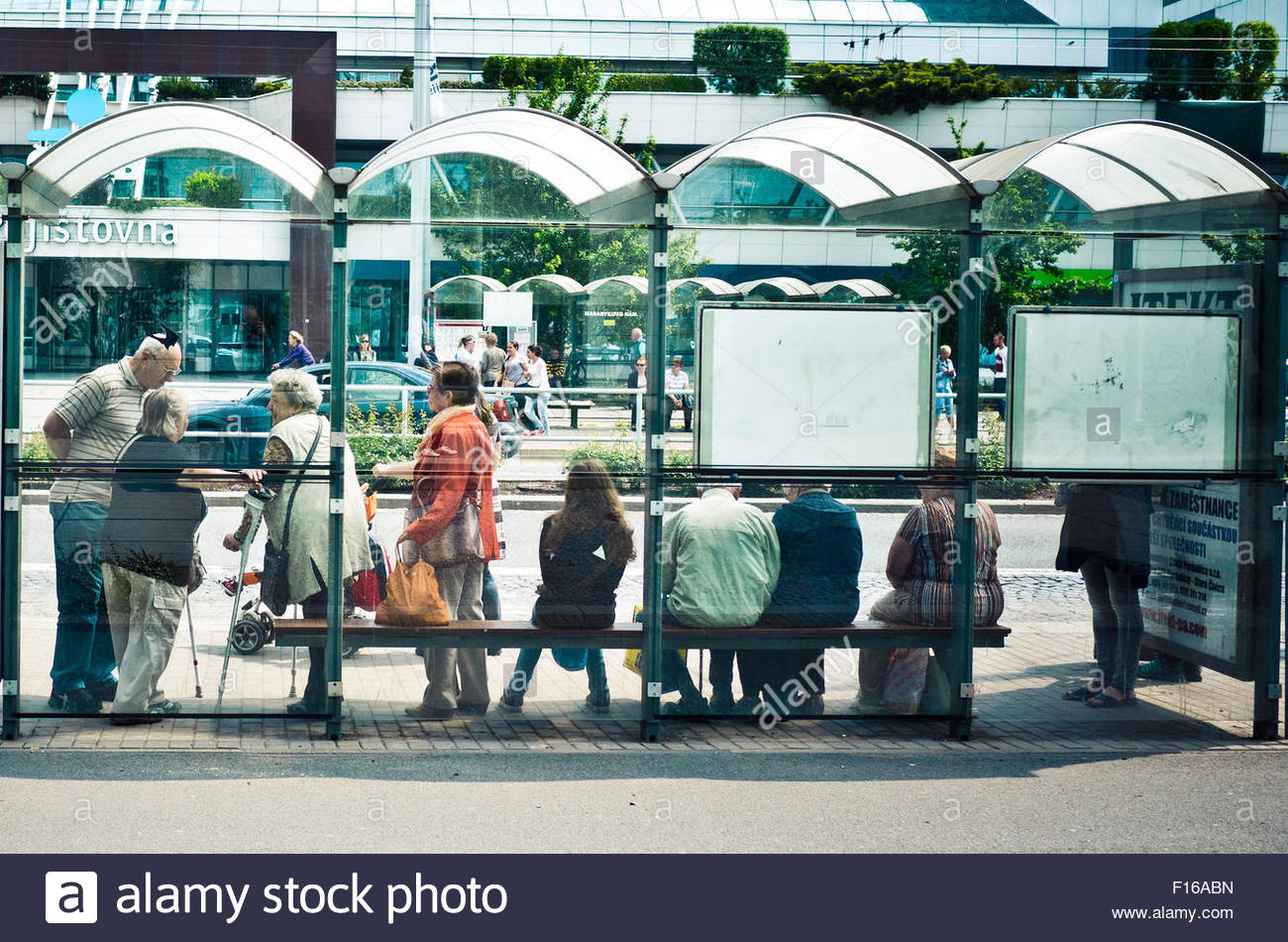 people waiting bus at the bust stop - Stock Image
