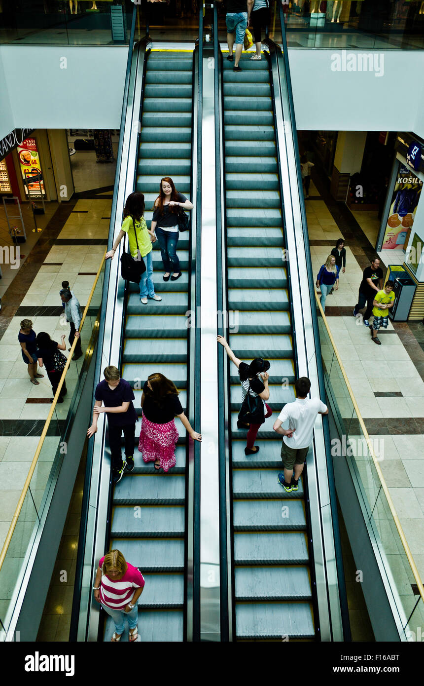 people on escalators in a shopping mall - Stock Image