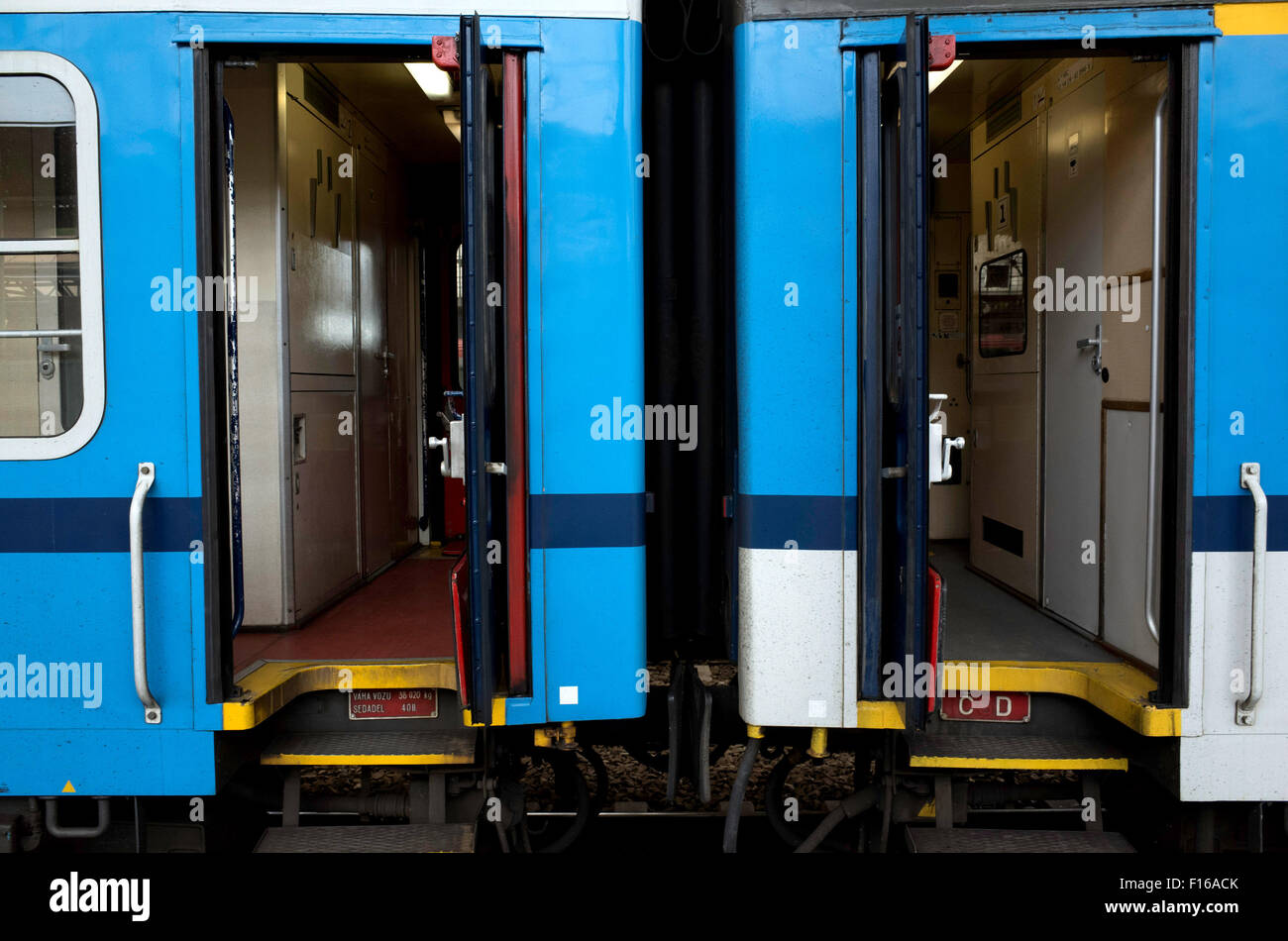 two train carriages, at the railway station, doors open - Stock Image