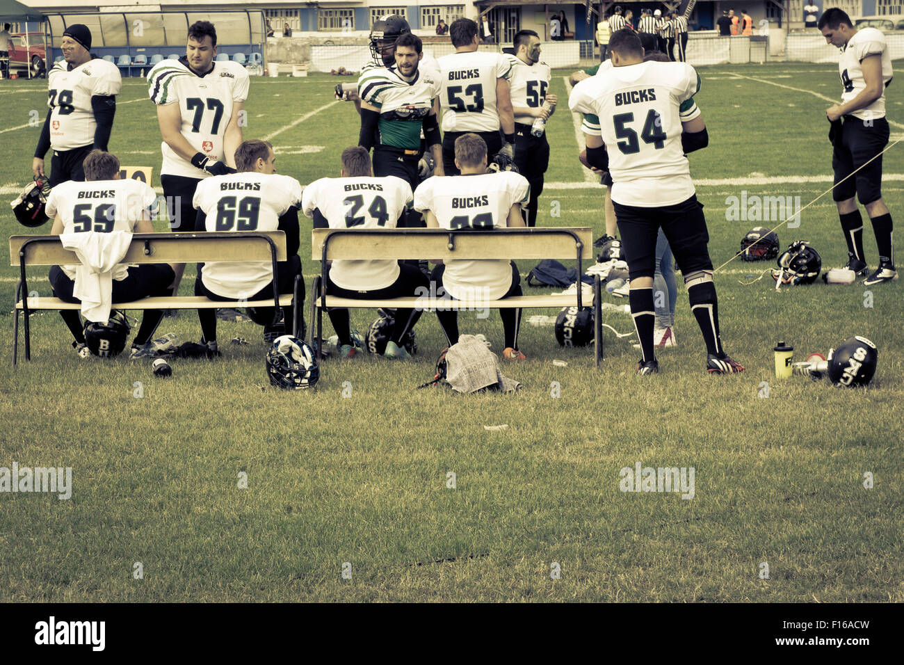 team of American football players on the sideline - Stock Image