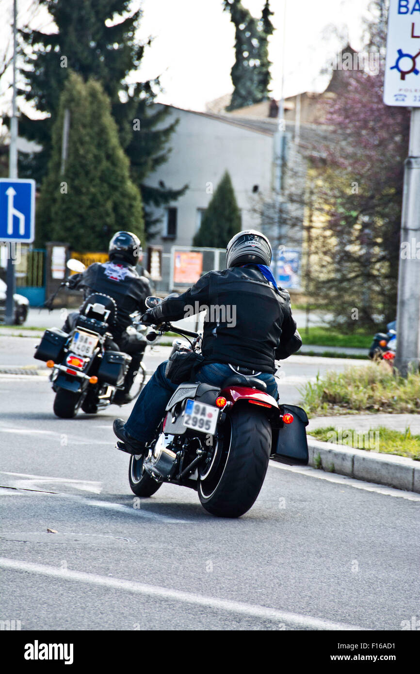 bikers on motorcycles in city street - Stock Image