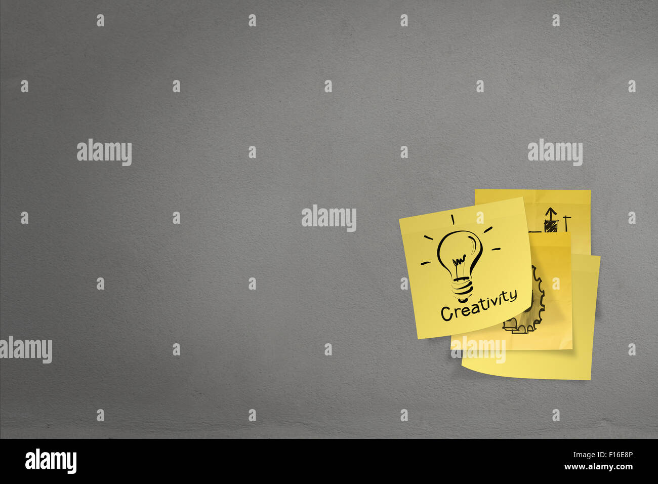 lightbulb as creative on crumpled sticky note paper on texture wall as concept - Stock Image