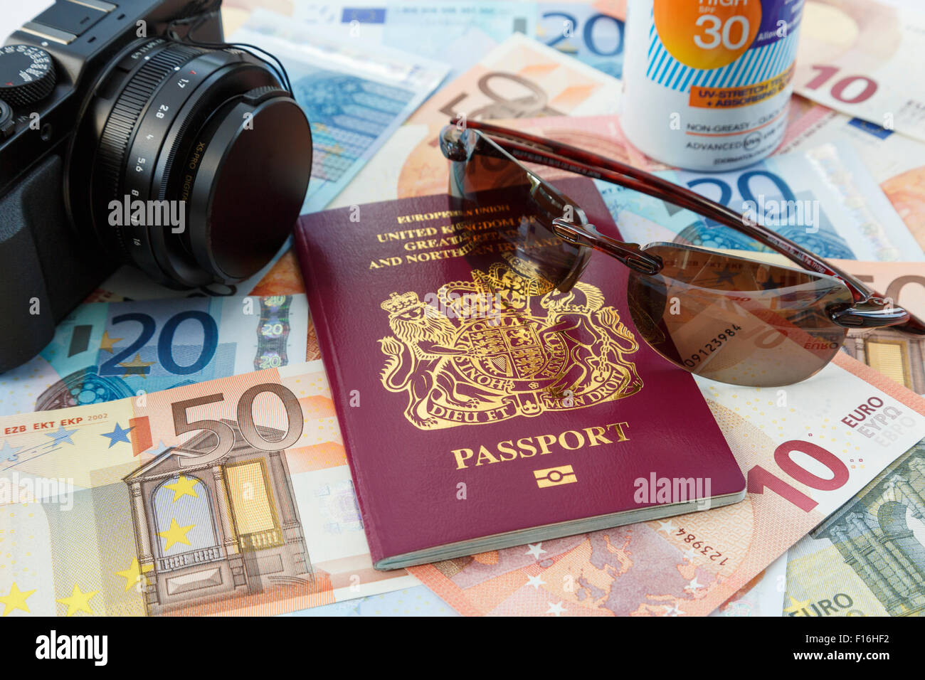 Things for foreign travel with passport currency camera suncream and sunglasses for travelling to Eurozone countries - Stock Image