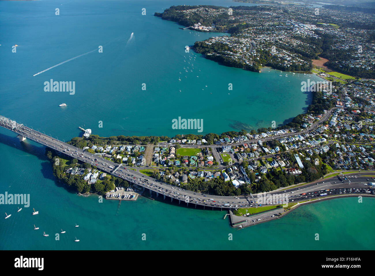 Northcote Point, Little Shoal Bay, Auckland Harbour Bridge approach, and Waitemata Harbour, Auckland, New Zealand - Stock Image