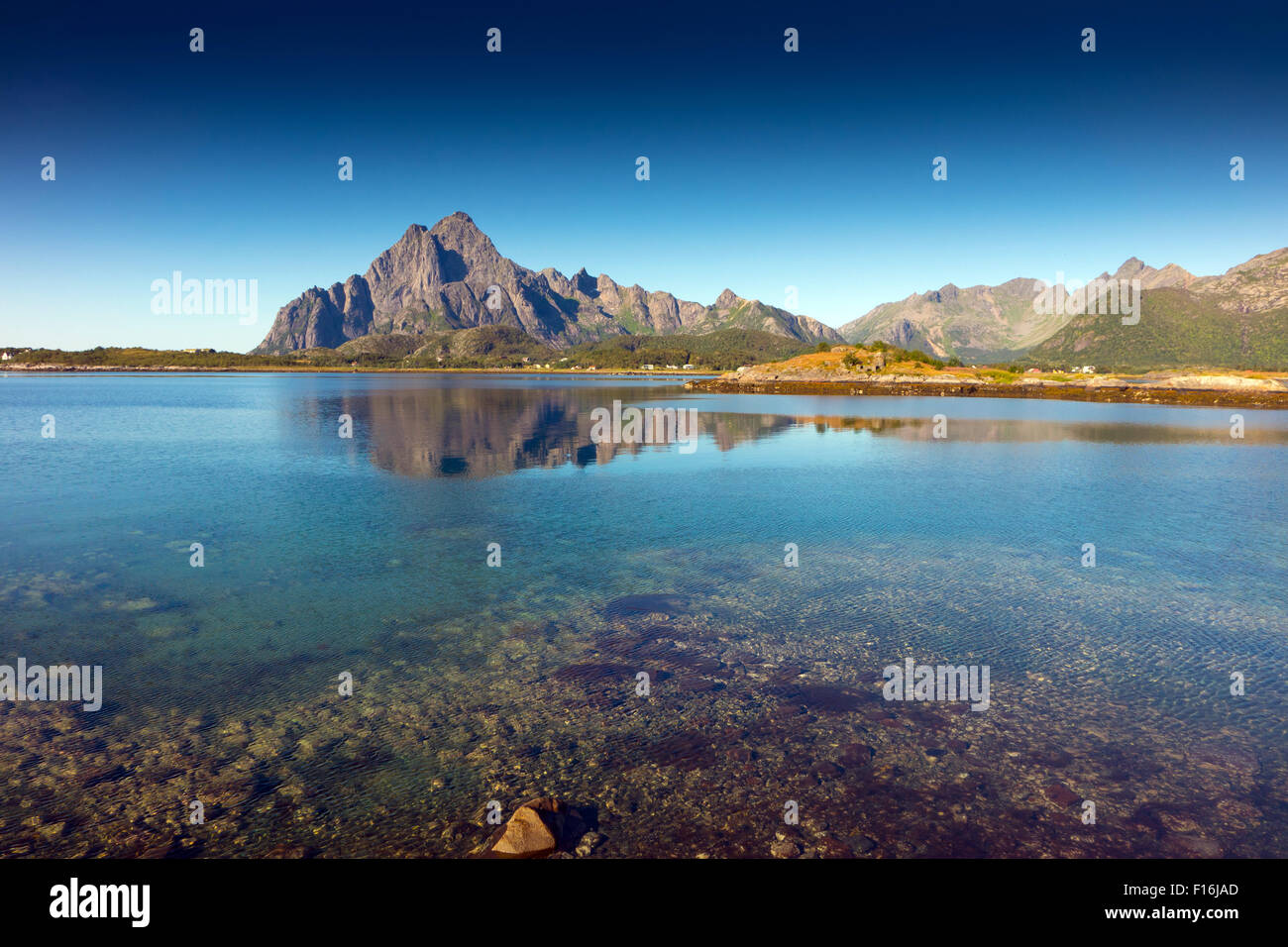 Tranquil conditions with reflections, Orsvagvaer, with Vagakallen mountain Lofoten, Arctic Norway, - Stock Image