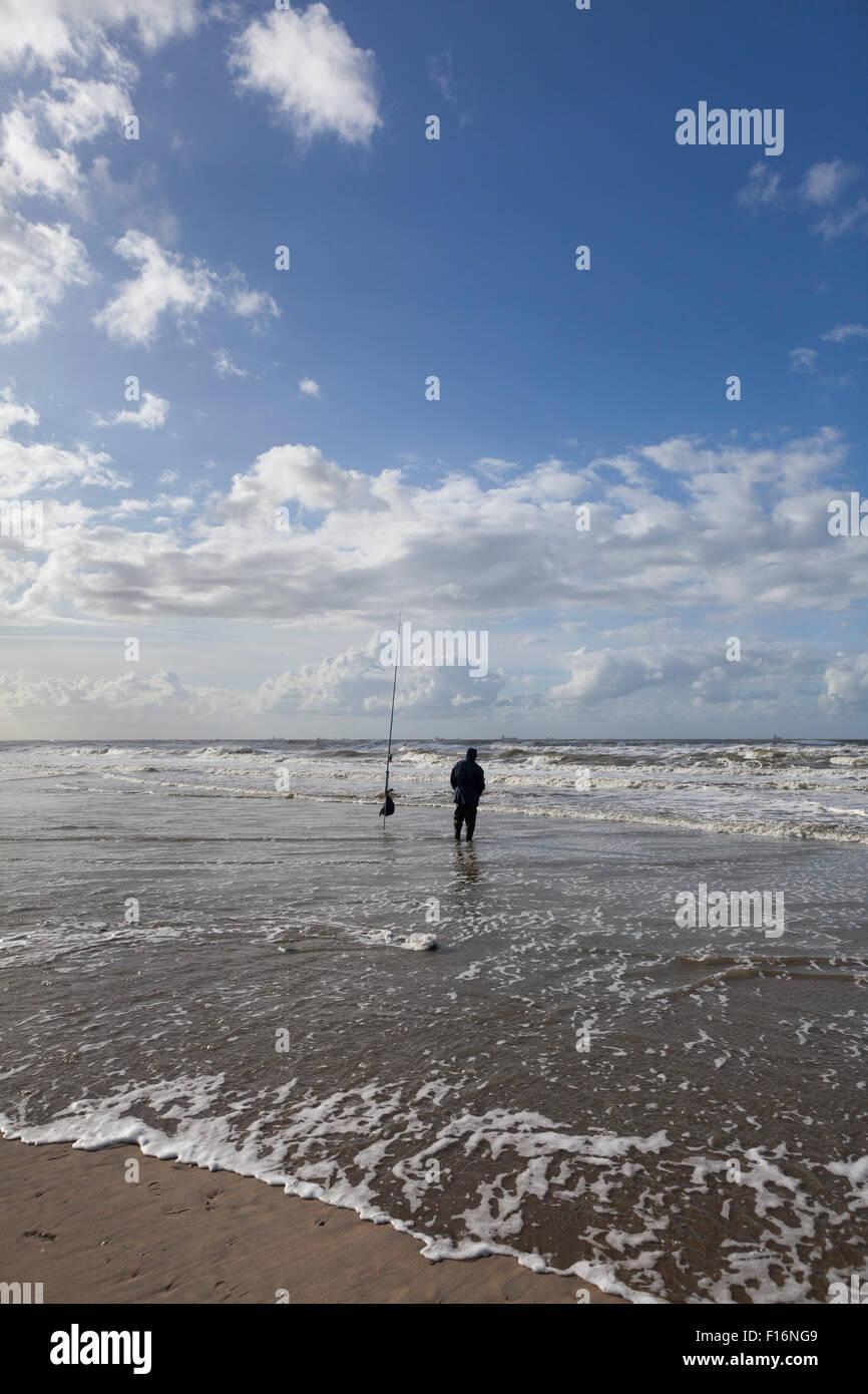 Fisherman fishing in the North sea - Stock Image