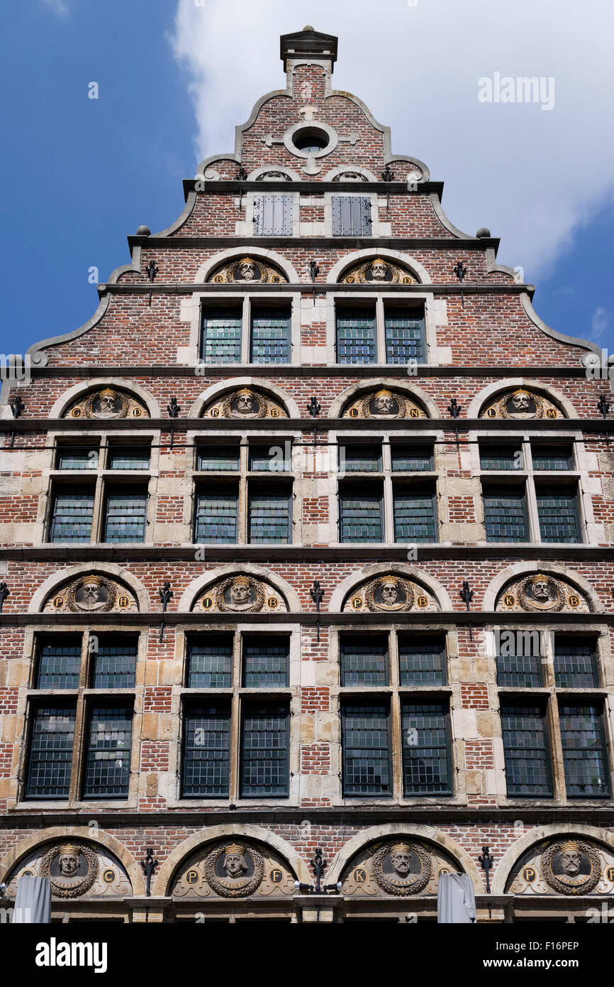 The crowned heads in a facade of a stepped gable in Ghend, Belgium - Stock Image