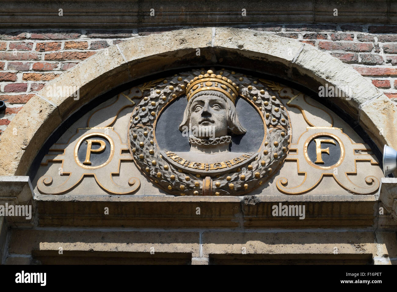 One of the crowned heads of a facade in Ghend, Belgium - Stock Image