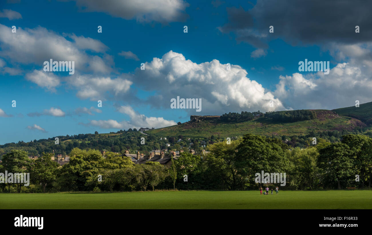 Looking up towards the famous countryside landmark, The Cow & Calf Rocks, from Ilkley on a beautiful day. - Stock Image