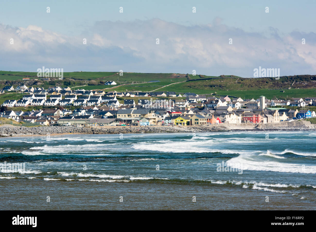 Waves in the Bay at the Town of Lahinch in County Clare along the Wild Atlantic Way on the West Coast of Ireland - Stock Image