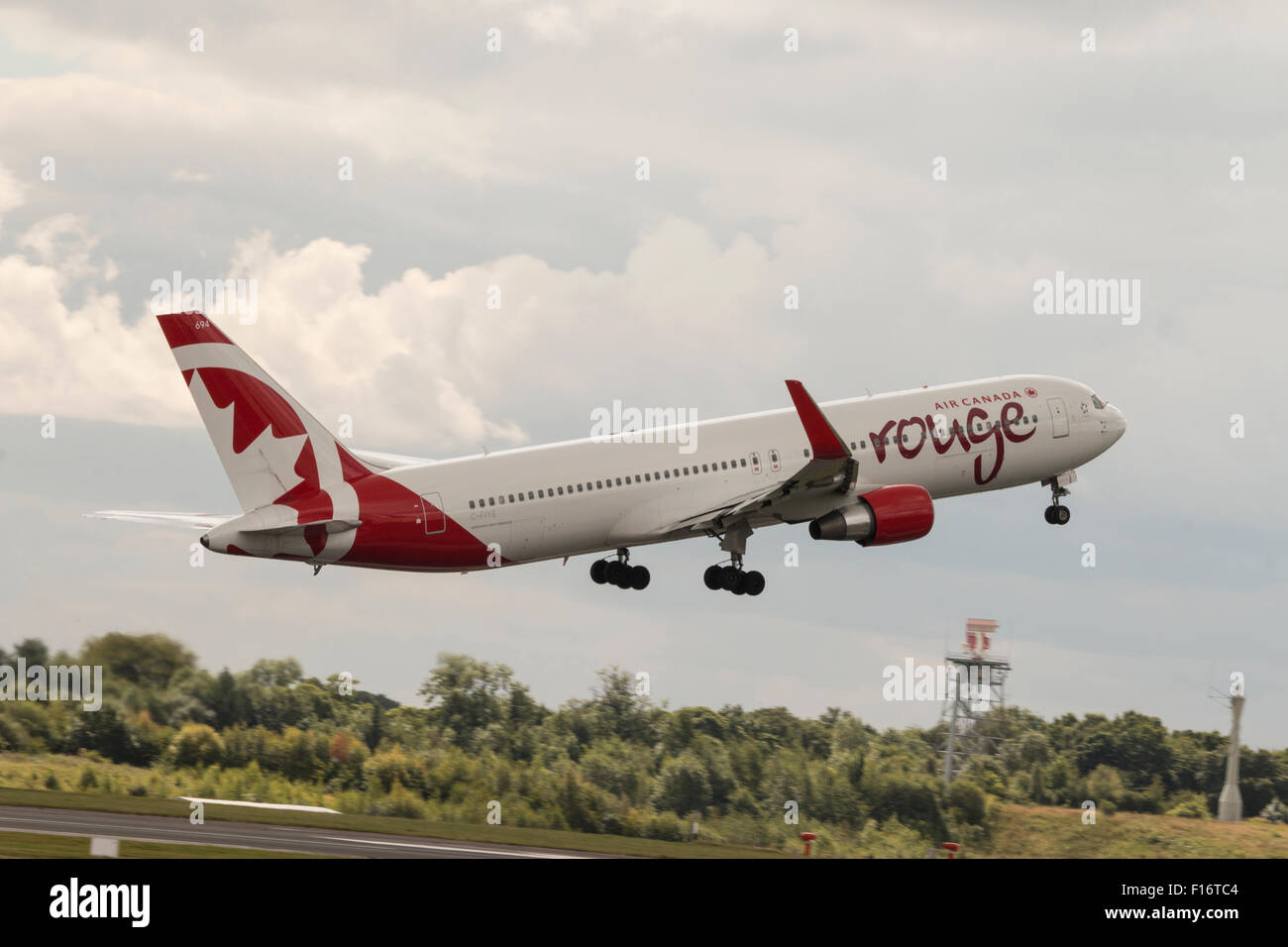 Air Canada Rouge Boeing 767-33A(ER) taking off at Manchester Airport (UK). Stock Photo