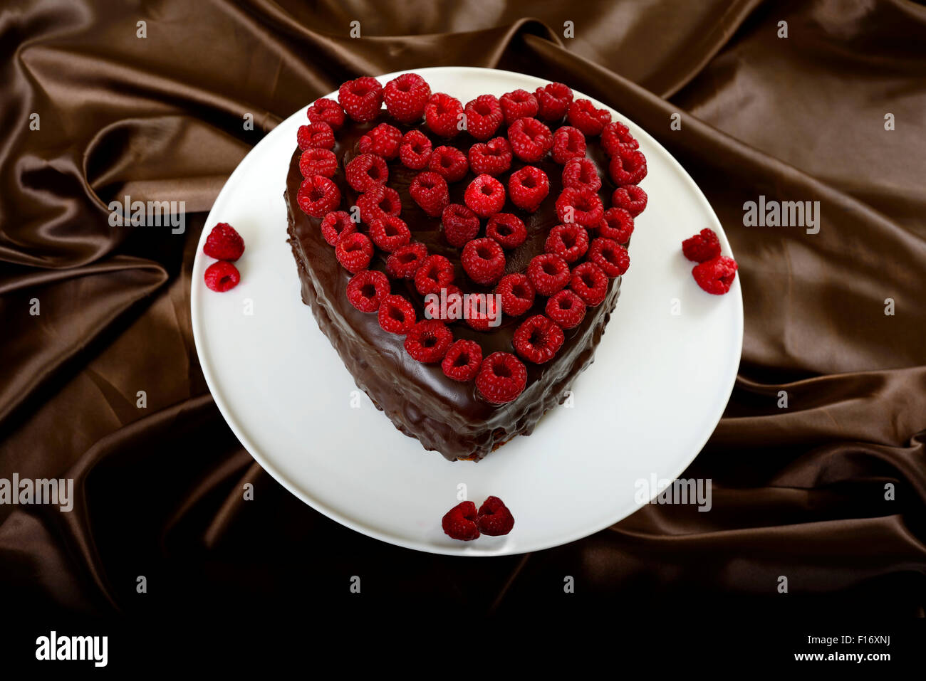 Valentines Heart Shaped Chocolate Cake Decorated With Raspberries