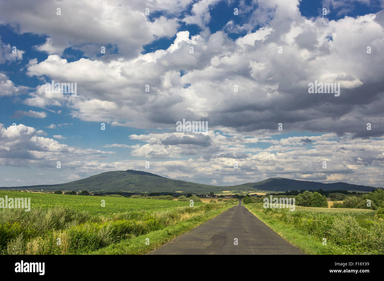Dramatic grey white cumulonimbus clouds in the sky over Mount Sleza Lower Silesia Poland - Stock Image